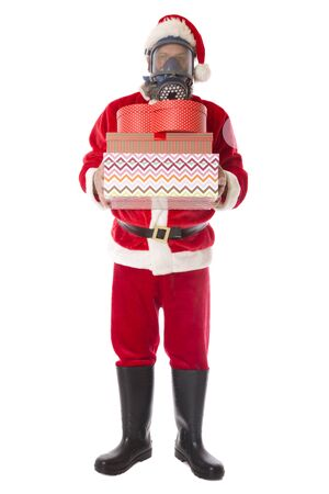 Santa wearing protective gear against coronavirus, sad Christmas concept. Stock Photo