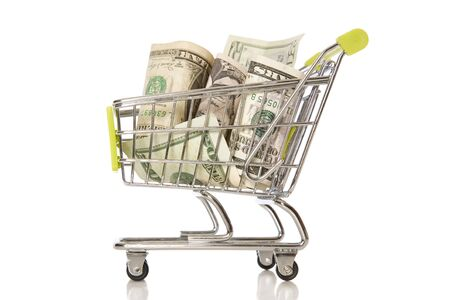 A shopping trolley with American Currency in it.