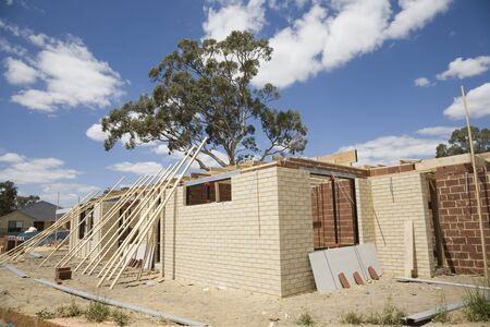 A brick house under construction in an Australian country town.