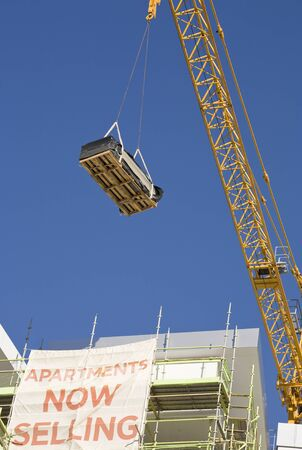 A crane lifting equipment for a construction project.