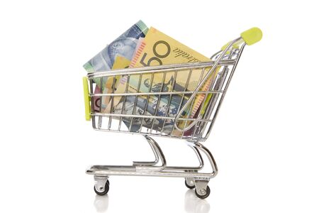 A shopping trolley with Australian Currency in it. Banco de Imagens