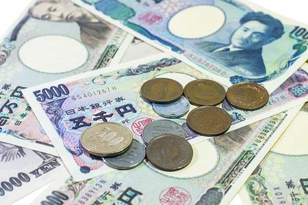 Japanese yen banknotes and yen coins or Japanese cash money spread isolated on white background