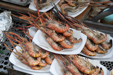 griller: Seafood grill at Ampawa Floating Market, Thailand Stock Photo