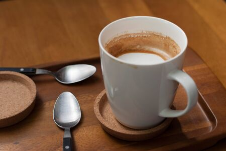 half full: A half full cup of coffee, caffe latte Stock Photo