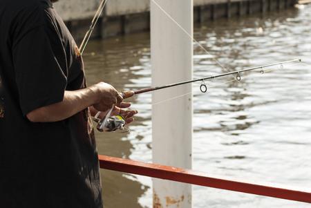chao phraya river: A man use fishing rod to fish from Chao Phraya River, Bangkok, Thailand Stock Photo