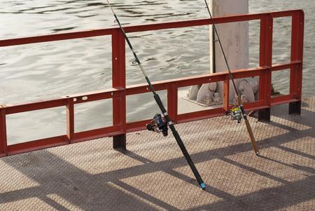 chao phraya: A man use fishing rod to fish from Chao Phraya River, Bangkok, Thailand Stock Photo