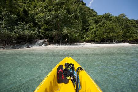 sandal tree: Kayak arriving at Koh Yuak, an uninhabited island in Trat, Thailand Stock Photo