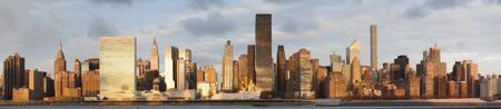long island: Panorama of Manhattan Skyline at Sunrise from Long Island