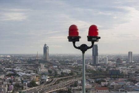 warning lights: Aircraft Warning Lights on a rooftop of a skyscraper in Bangkok, Thailand Stock Photo