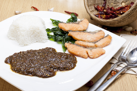 Fried salmon with Thai style chili paste on rice