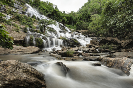 MaeYa Waterfall is the biggest and the most beautiful waterfall in Doi Inthanon National Park, Chiang Mai Province. With a height of over 260 metres, Mae Ya Waterfall, which falls into a series of cascades down towards the pool, can be seen from a very fa Stock Photo