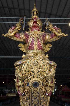 The figurehead of the Royal Barge Narai Song Suban, Vishnu god mounted on a garuda holding on Naga. Porthole for cannon beneath the Garuda. Decorated with golden lacquer and glass ornaments 新聞圖片
