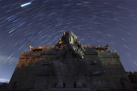 Star trails above Guan Yin statue at 500 Lohan Temple, Bintan Island, Indonesia