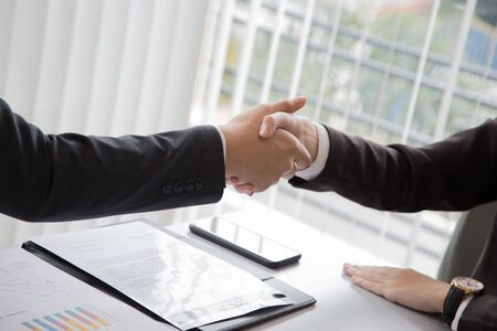 two businessman handshaking for successful deal after negotiation in meeting Stock Photo