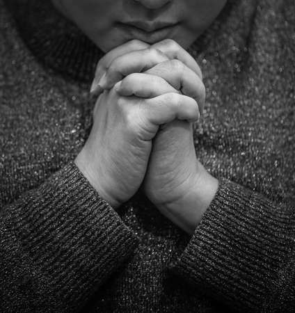 Woman's hand praying and worship to GOD Using hands to pray in religious beliefs and worship christian in the church or in general locations in vintage color tone or copy space. Foto de archivo