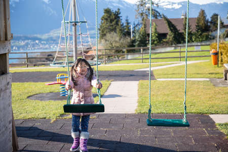 The image of the playing field in the park has many games that are wanted by the children, safe and beautiful, colorful, the ground is made of green grass on clear days.