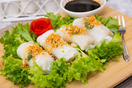The image of spring rolls stuffed with vegetables as a snack or as a meal in every meal for a healthy Thai style meal in a beautiful wooden backdrop.