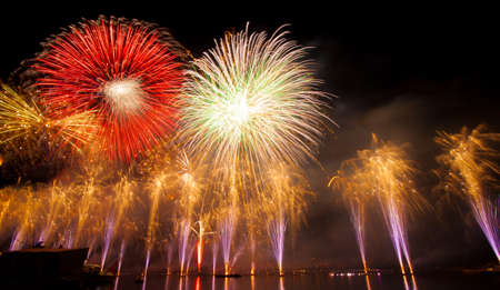 Firework festival, fireworks, New Years Day, music and celebration on the lake in Geneva, Switzerland background at night