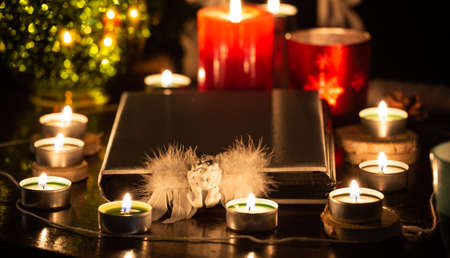 Pictures of candles and books for ritual, mysticism and mysteries about superstition. Concept Divine magic & occultism Banque d'images