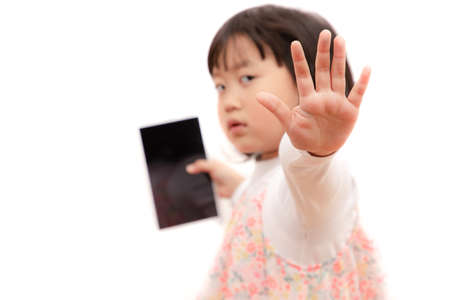 Young girls playing mobile phones on the road or the house cause an accident Or using mobile phones for a long time may cause damage to the eyes Hazardous concepts for children's mobile phones ...