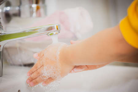 washing hands in a hospital or home with liquid soap mixed with antiseptics. prevent Viruses covid19 and antibacterial concept of caring for the cleanliness of hand washing.