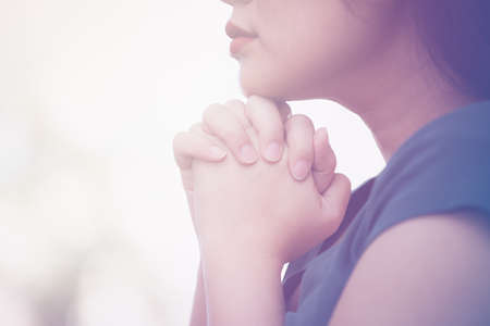 woman praying and worship to GOD Using hands to pray in religious beliefs and worship christian in the church or in general locations in vintage color tone or copy space. 版權商用圖片