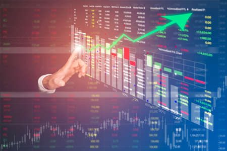 Businessman touch line arrow on the graph chart of stock market ,Technology Process System Business with Investment and stock market concept gain and profits with faded number charts.
