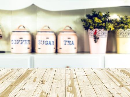 Wood table top on kitchen blurry backgrounds. Foto de archivo