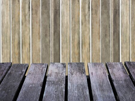 bokeh background: Wood wall blurred background and brown wooden floor.  Soft focus on floor Stock Photo