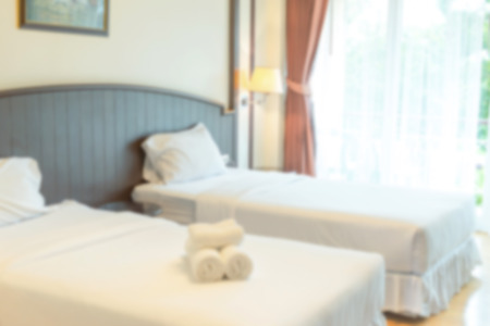 bedstead: Blurry image.  A warm bedroom with sunlight shining through the terrace Stock Photo