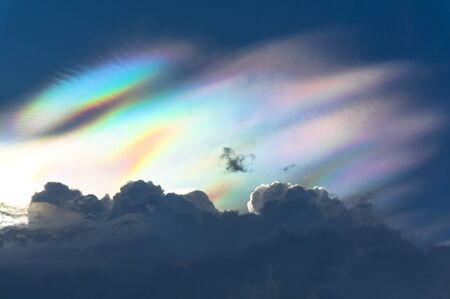 Natural phenomenon.  Multi-color appear on sky over rainclouds Stock Photo