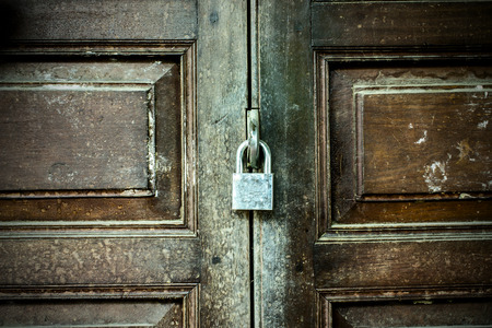padlocked: The old door with a key lock