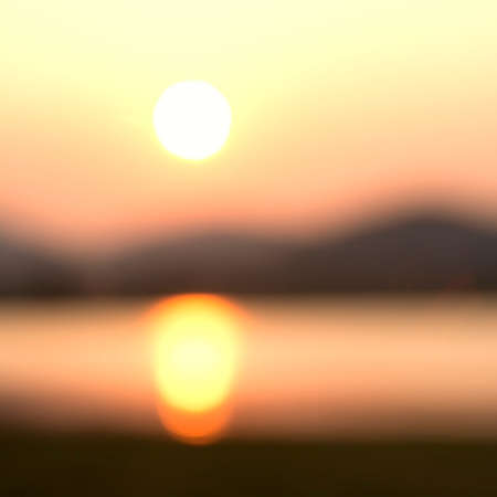 over hill: Blurred sunrise over hill and lake for background Stock Photo