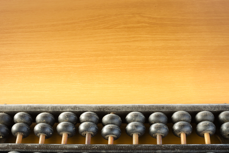 compute: Some part of the abacus placed on a wooden table Stock Photo