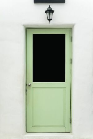 green door: Green door isolated on White wall Stock Photo