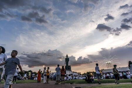 candlelit: Vesakabucha day, Many people came forward to join candlelit procession at Praphuttamonthon courtyard, Nakornpathom, Thailand. Editorial