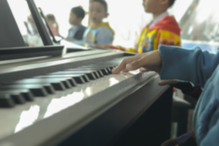 pratice: Blurry image. Childrens hands on the piano