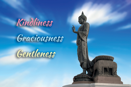 gentleness: Buddha statue against on blue sky blurred background.  3 Words Stock Photo
