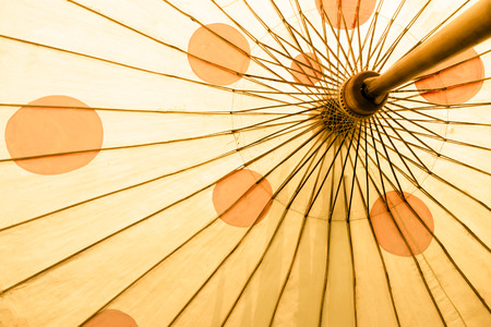 round rods: Under the shade of umbrella. Look up to umbrella
