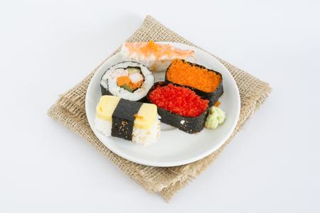 gaining: Sushi.  Japanese food in Thailand. Gaining popularity.