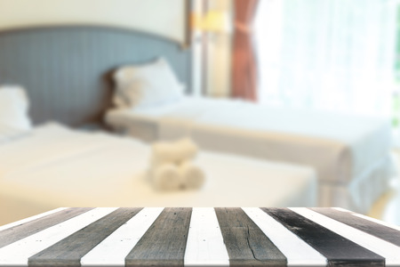 empty room background: Wood empty table for display product and blurry bed room in background Stock Photo