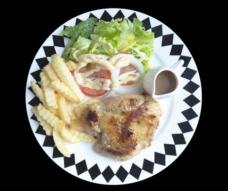 Grilled chicken steak isolated on black background. Stock Photo