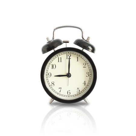Alarm clock setting at 9 AM or PM isolated on white background.  This has clipping path.