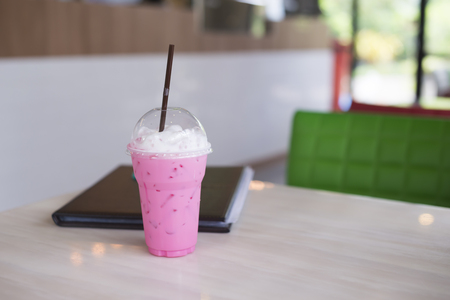 Pink milk sweet drink on table in the restaurant. Stock Photo