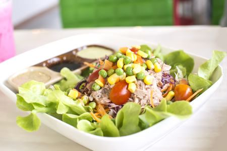 Mixed vegetable salad with tuna. Healthy food.