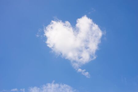 Blue sky with heart shape clouds. Valentine concept.