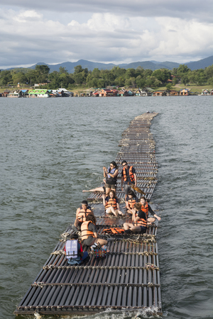 September 04, 2017 : Tourists floating on the river by wooden raft in Srinakarin Dam, Kanchanaburi, Thailand.