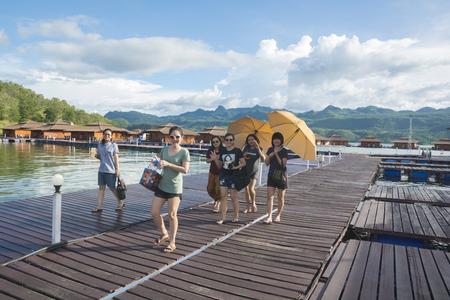 September 04, 2017 : Tourists  walking on wooden raft in the resort at Srinakarin Dam, Kanchanaburi, Thailand.