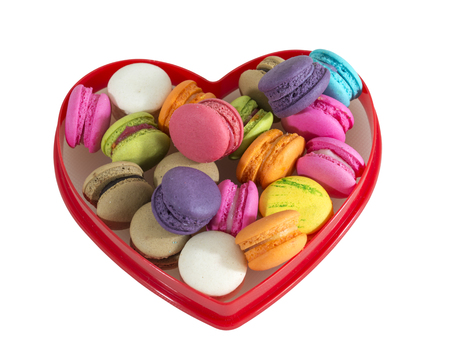 Colorful macaroons in the red heart shape isolated on white background. This has clipping path. Stock Photo