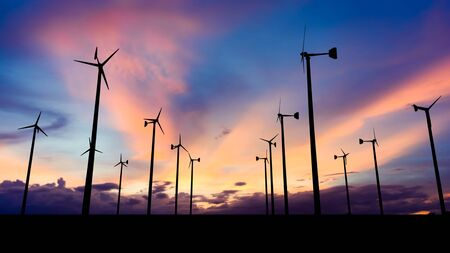 Silhouette image of Wind turbine with Sunset sky.